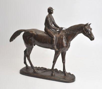 BUREAU Jockey sur son cheval Épreuve en bronze à patine brune. Fonte d'édition sans...