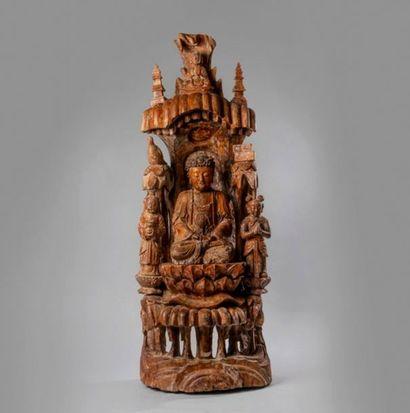 STATUETTE de Bouddha assis en bois reposant...