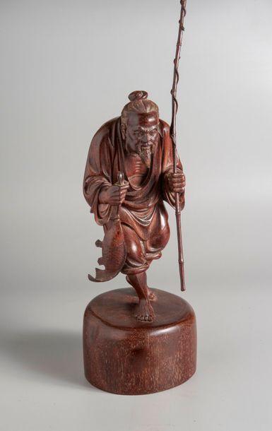 SUJET EN BOIS représentant un pêcheur.  Chine,...