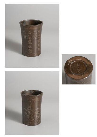 BRULE-ENCENS en bronze à patine brune à décor...