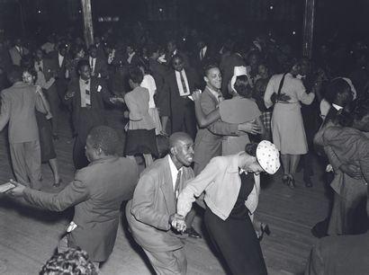 AFP - Eric SCHWAB AFP - Eric SCHWAB  Night-club dans Harlem, à la fin des années...