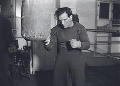 AFP AFP  Marcel Cerdan à l'entrainement en 1946.  Photographie sur papier baryté...