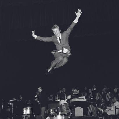 AFP AFP  Claude François à l'Olympia lors de répétitions avant le concert de 1964....