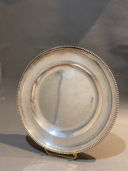 Plat rond en argent 950 °/°° à bordure perlée....