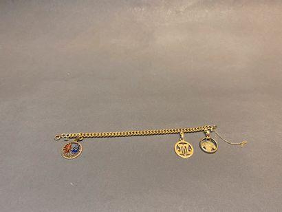 Bracelet gourmette en or 750 °/°° orné de...