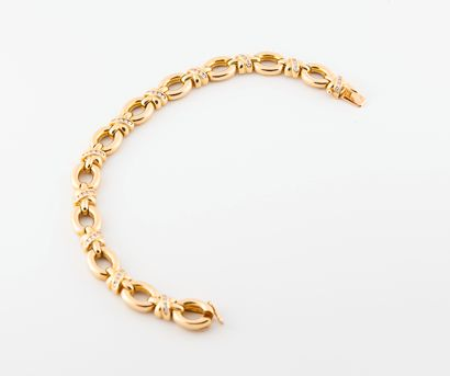 Bracelet articulé en or 750°/°° à maillons...
