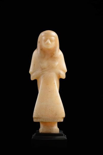 Rare et important shaouabti contremaître portant la jupe à deux vantaux triangulaire...
