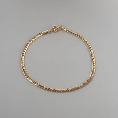 Bracelet en or 750 °/°° maille gourmette...