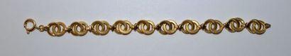 Bracelet en or 750 °/°° à maillons d'anneaux...