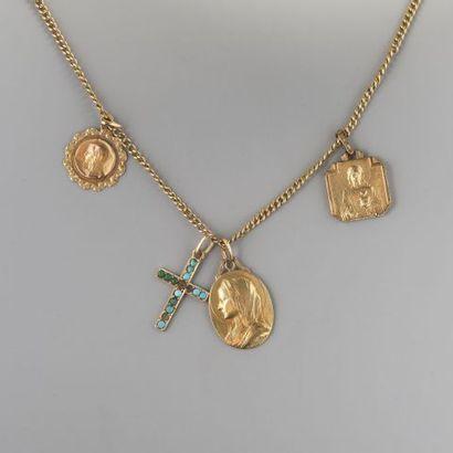 Chaîne en or 750 °/°°ornée de deux médailles...