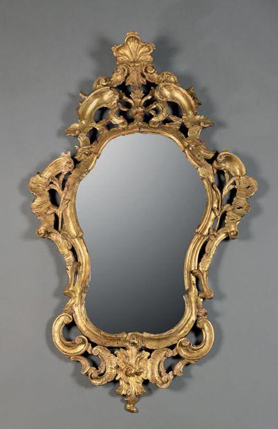 Gilded wooden mirror with openwork decoration...