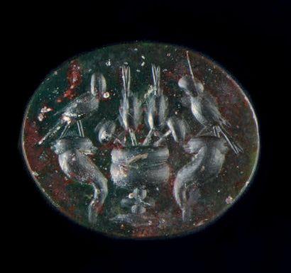 Intaille ovale plate gravée d'un vase sur piédouche contenant des épis et des pavots,...