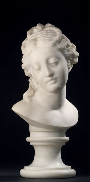 White marble woman's head on pedestal base....