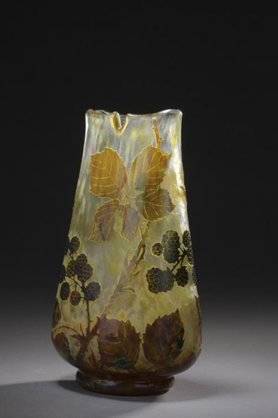DAUM  Vase with a flattened ovoid body, four notched neck  hot-molded on heel heel....