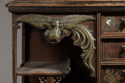 Small cabinet in stained wood, the upper part  formed by a showcase flanked by niches...