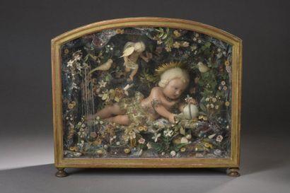 Diorama représentant l'enfant Jésus en cire,...