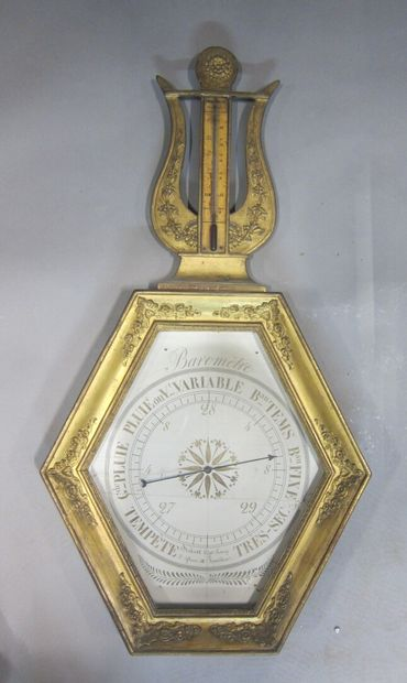 Baromètre-thermomètre en bois à décor appliqué...
