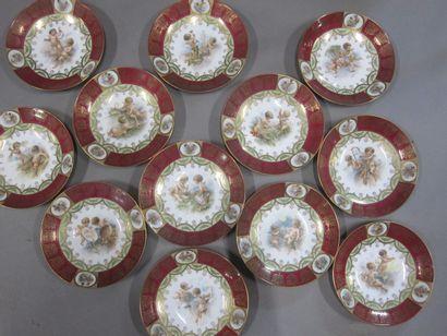 Douze assiettes en porcelaine à décor d'angelots....
