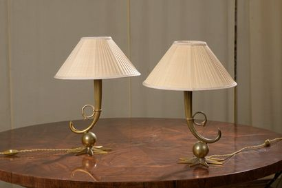FRENCH WORK  A pair of ormolu bedside lamps...