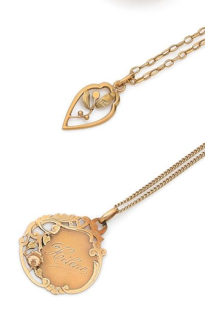 Lot of yellow gold jewelry including: a flower...
