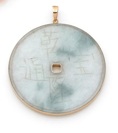 Jade disc pendant engraved with sinograms...