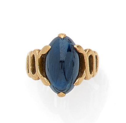 Ring set with a blue glass set with six claws...