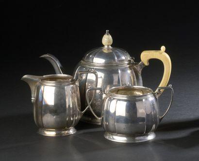 Silver tea set in a tonneau shape comprising...