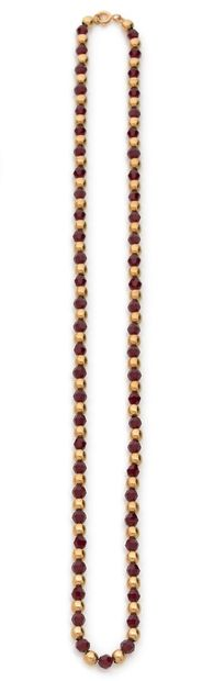 Necklace of alternating faceted red glass...