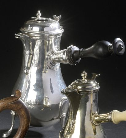 A silver tripod chocolate pot in the form...