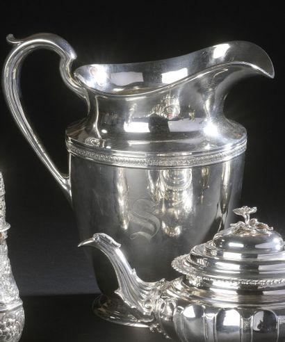 Silver pitcher, resting on a pedestal, carved...