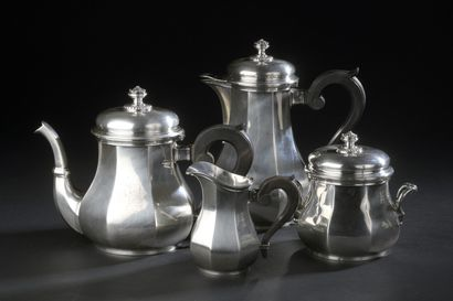 Silver tea and coffee set in the shape of...