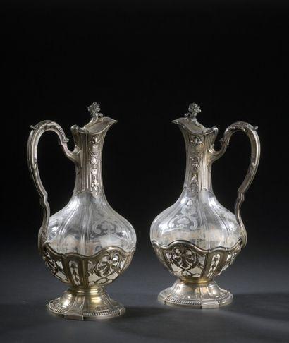 Pair of engraved crystal ewers on a pedestal,...
