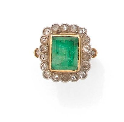 Ring set with a rectangular emerald in a...