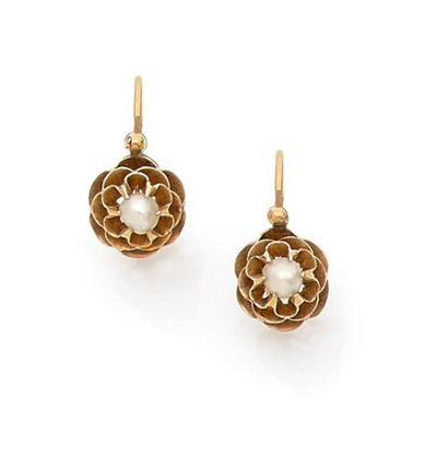 Three pairs of pearl earrings on yellow gold....