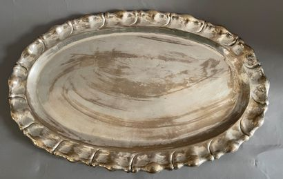 Oval silver dish with gadrooned decoration....