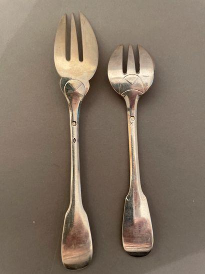 Suite of twelve silver cake forks in rat...