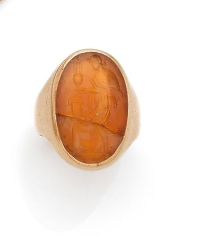 Yellow gold signet ring set with an oval...