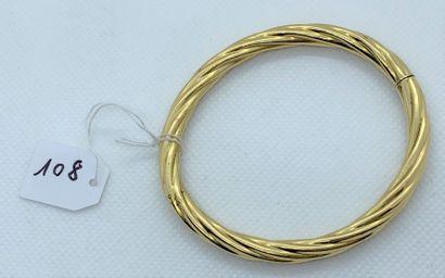 Rigid bracelet opening in 18K (750) yellow...