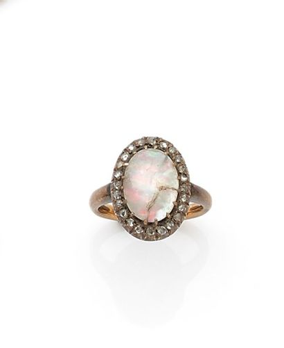 Antique ring set with an oval opal cabochon...