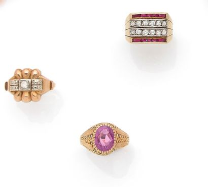 Set of three yellow gold rings: One amethyst ring, one adorned with a white stone...
