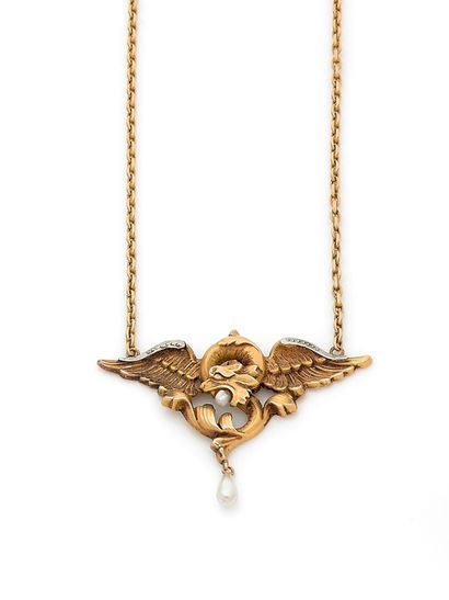 Yellow gold chimera pendant holding a pearl...