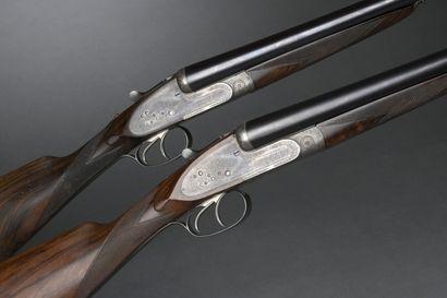 Paire de fusils juxtaposés à platines Henry...