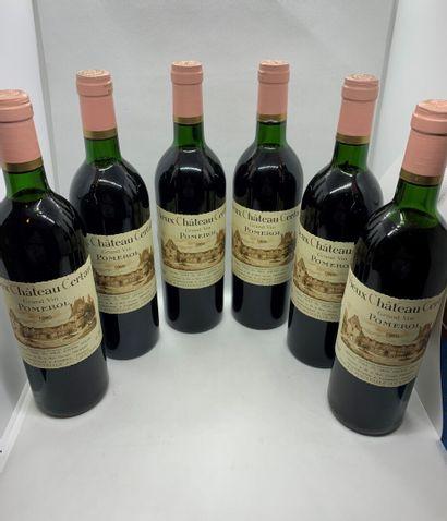12 bouteilles de Château VIEUX CHÂTEAU CERTAN Pomerol 1985 CBO, 7 base goulot, 4...