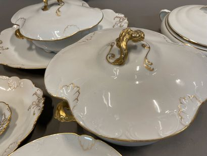 Small part of a porcelain dinner service with gilded shell decoration.