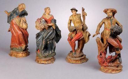 Quatre statuettes en bois sculpté polychrome...