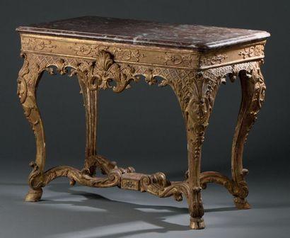Table console en bois doré, la ceinture à...