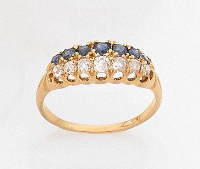•BAGUE en or jaune (585‰) 14 carats, serti...