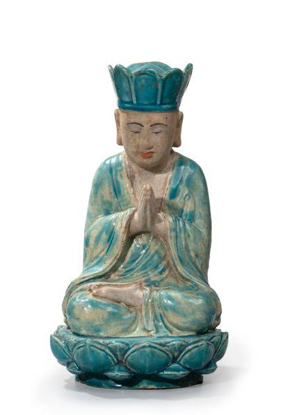 CHINE XIXème Un bouddha en céramique émaillée,...