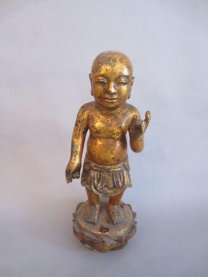 Sujet en bois laqué représentant le Bouddha...