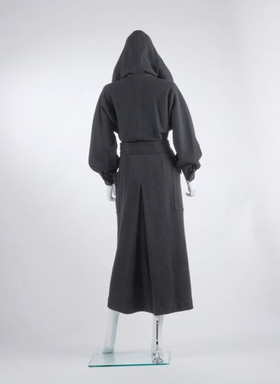 ISSEY MIYAKE - Fall-Winter 1975  Hooded coat in thick black wool jersey (approx....